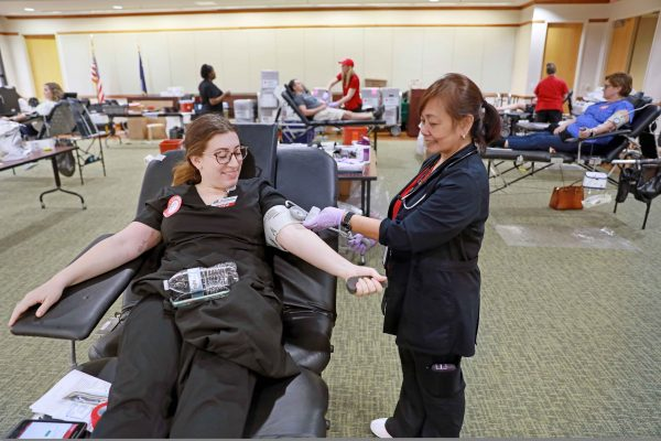 Nurse getting blood drawn during blood drive.