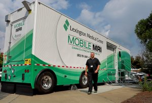 Man standing in front of Lexington Medical Center's Mobile MRI unit