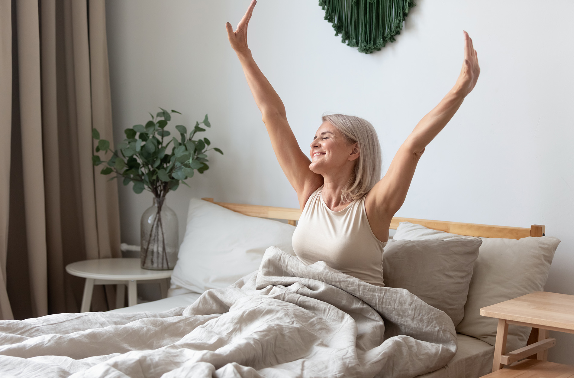 Woman awakening refreshed and happy