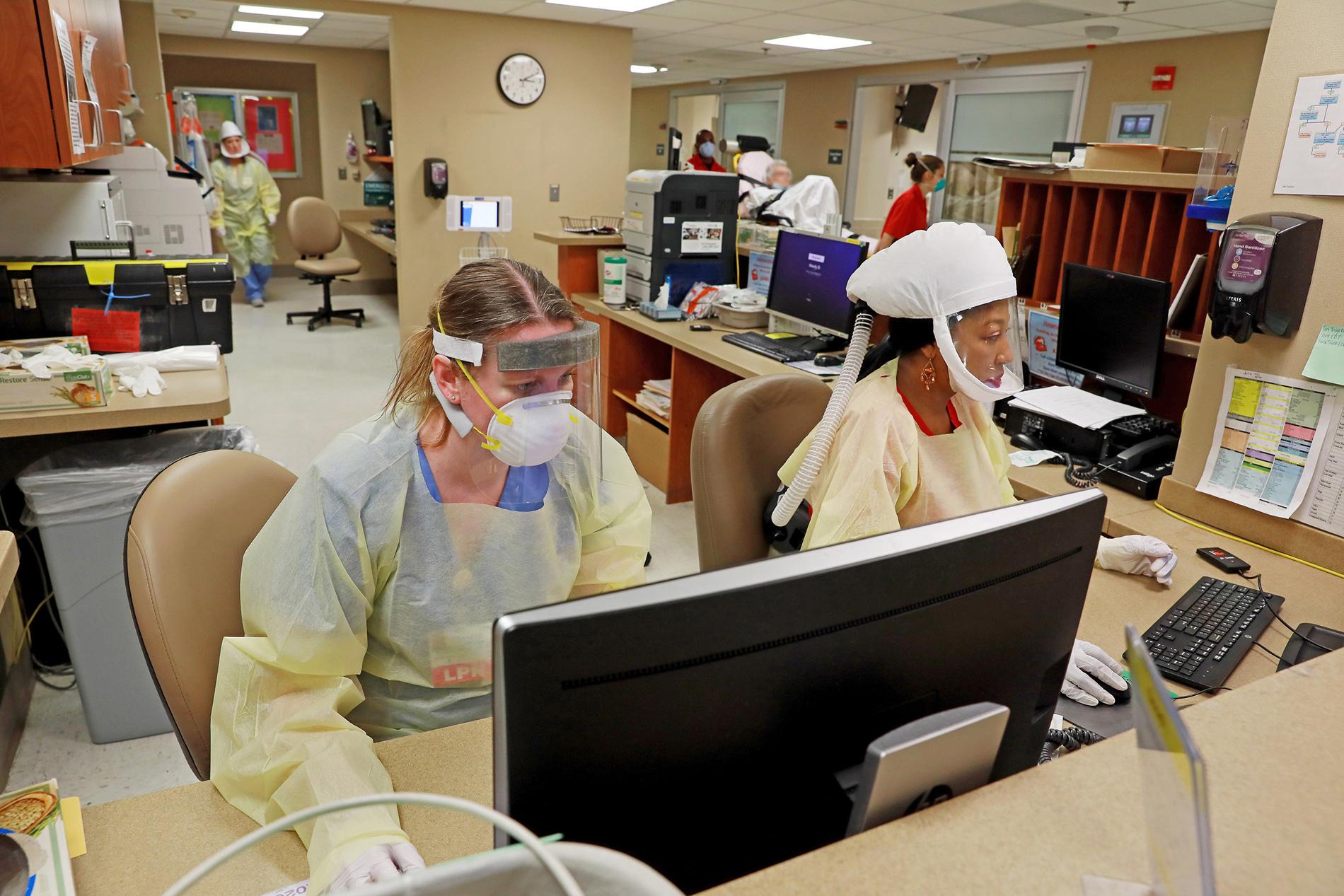 Nurses in COVID protective gear