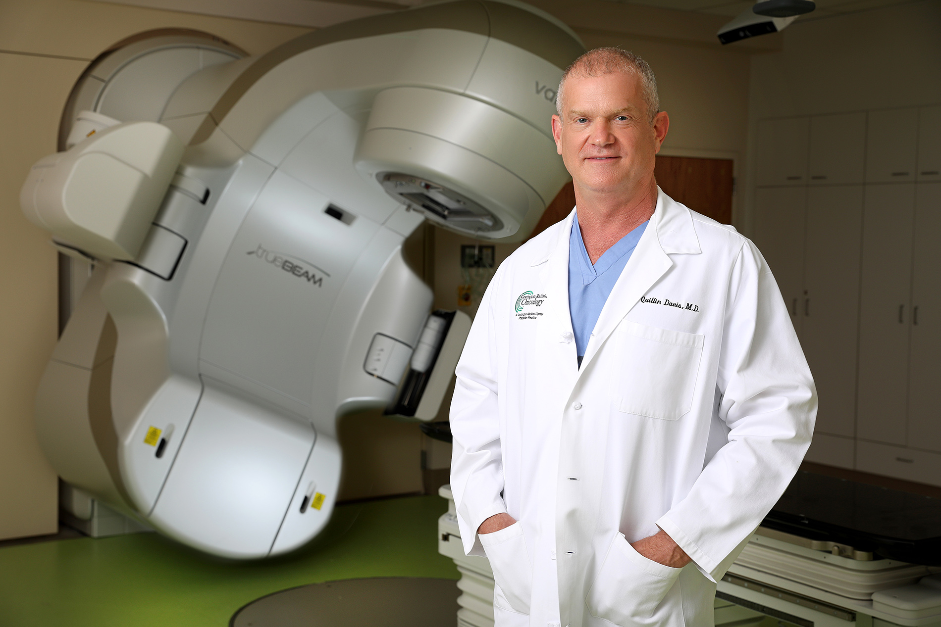 Dr. Davis standing in front in linear accelerator