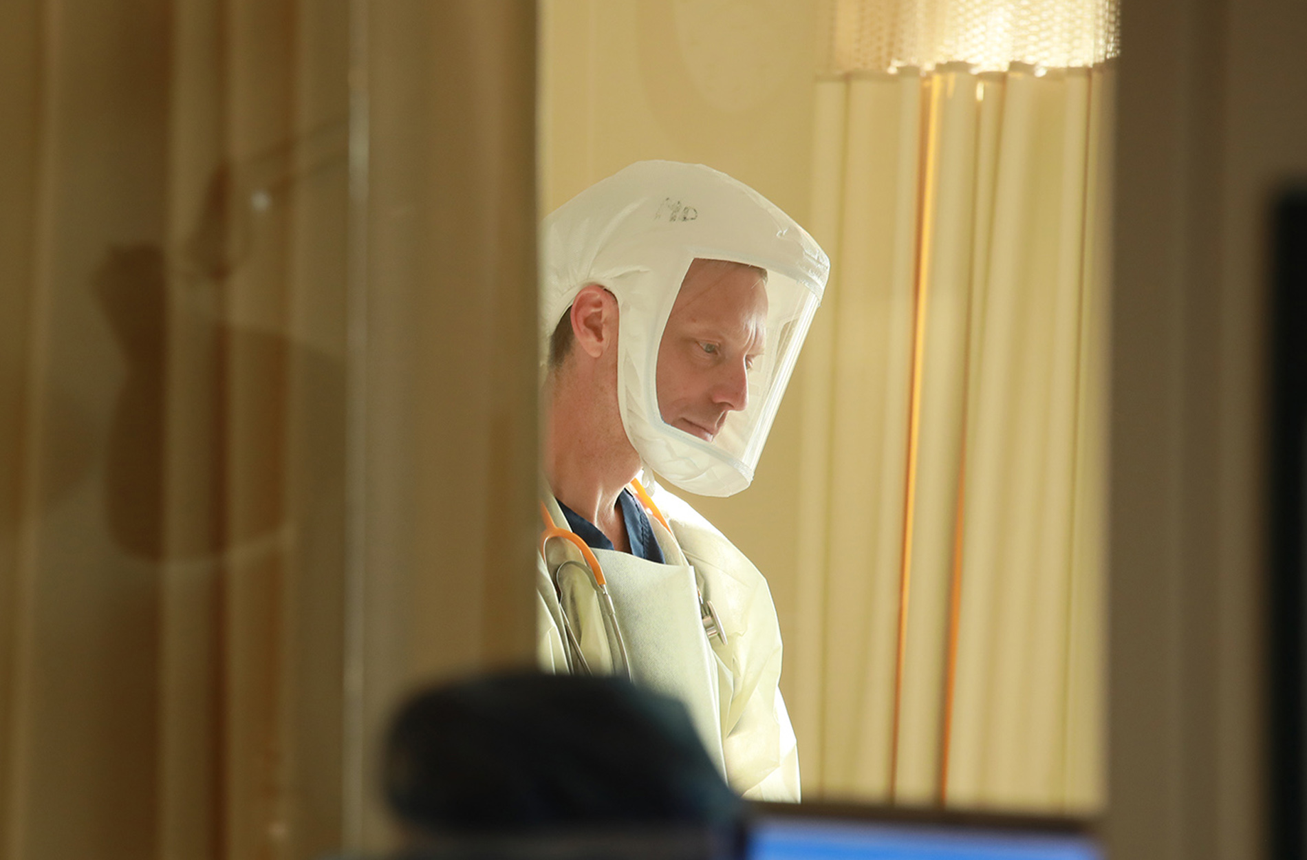 Dr. Keith in ICU wearing protective equipment