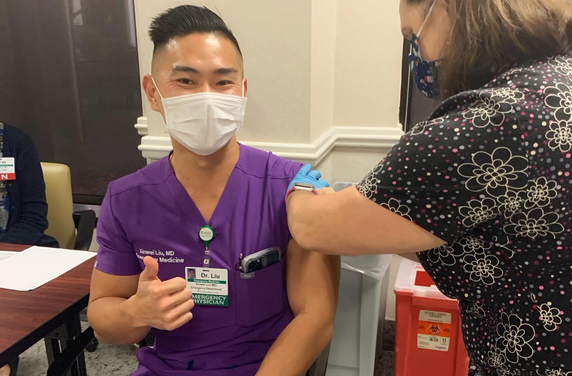Dr. Liu getting vaccine