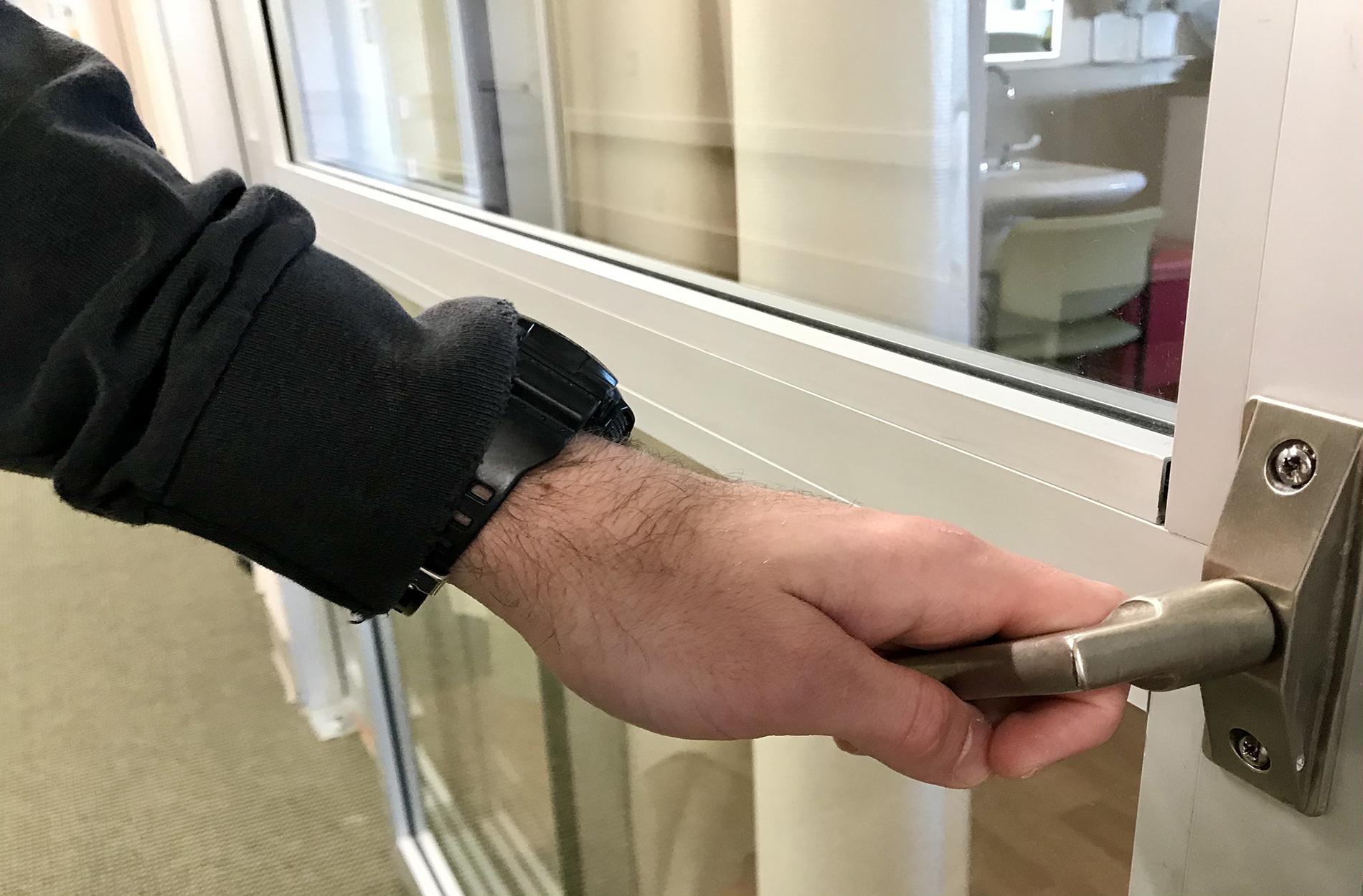 Hand opening patient room door