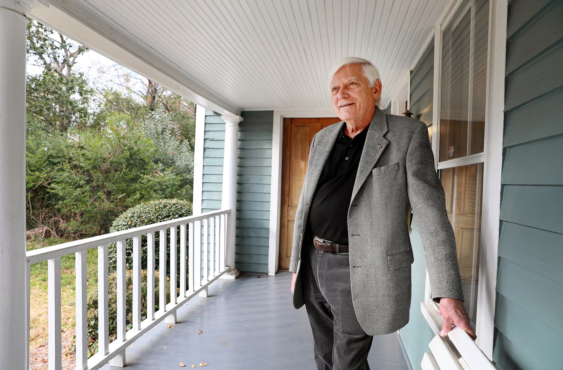 Dr. Harmon on porch of office