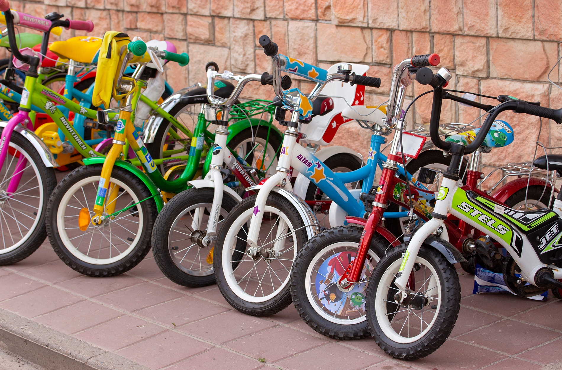row of children's bicycles