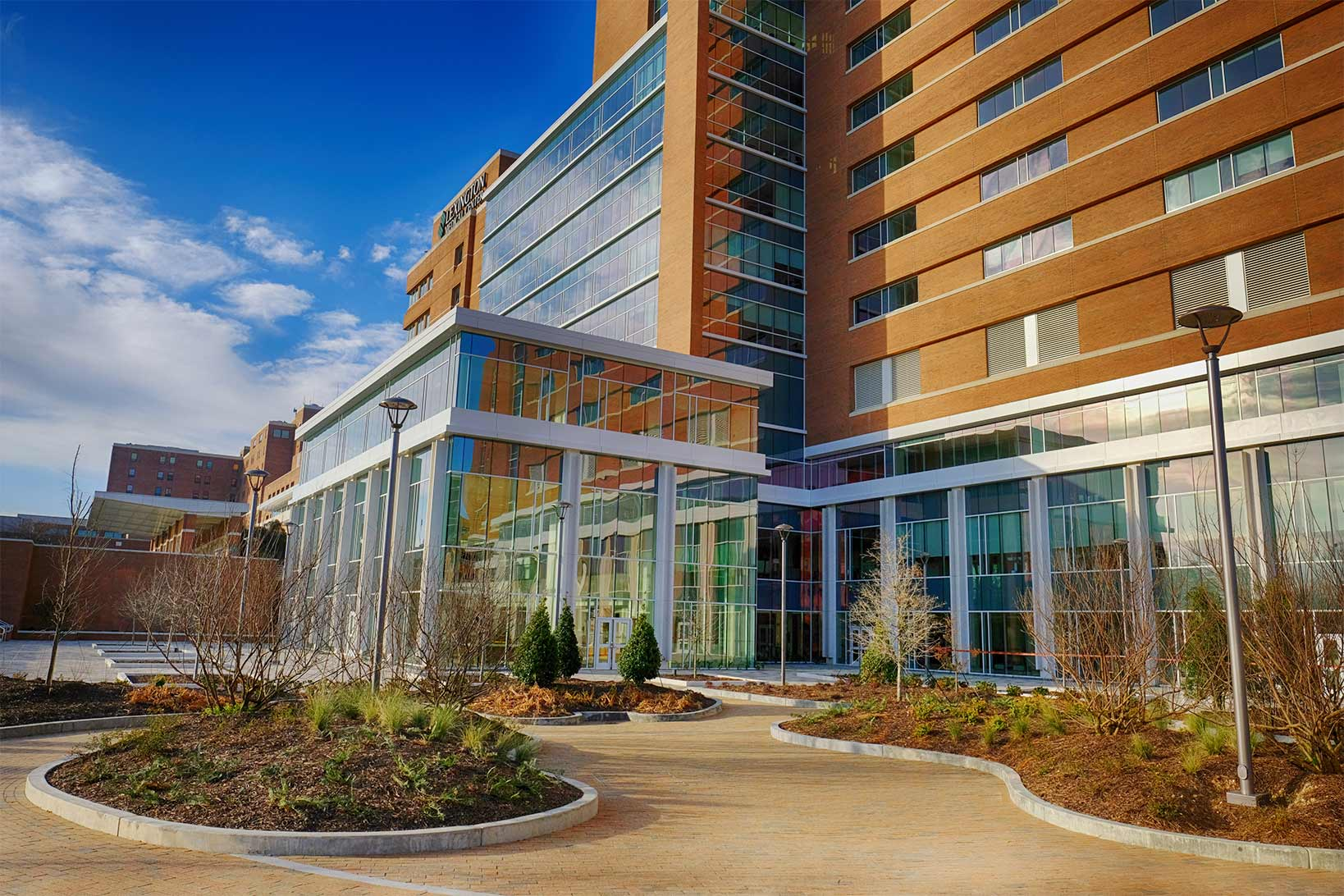 The front of Lexington Medical Center and the serenity garden on a sunny day.