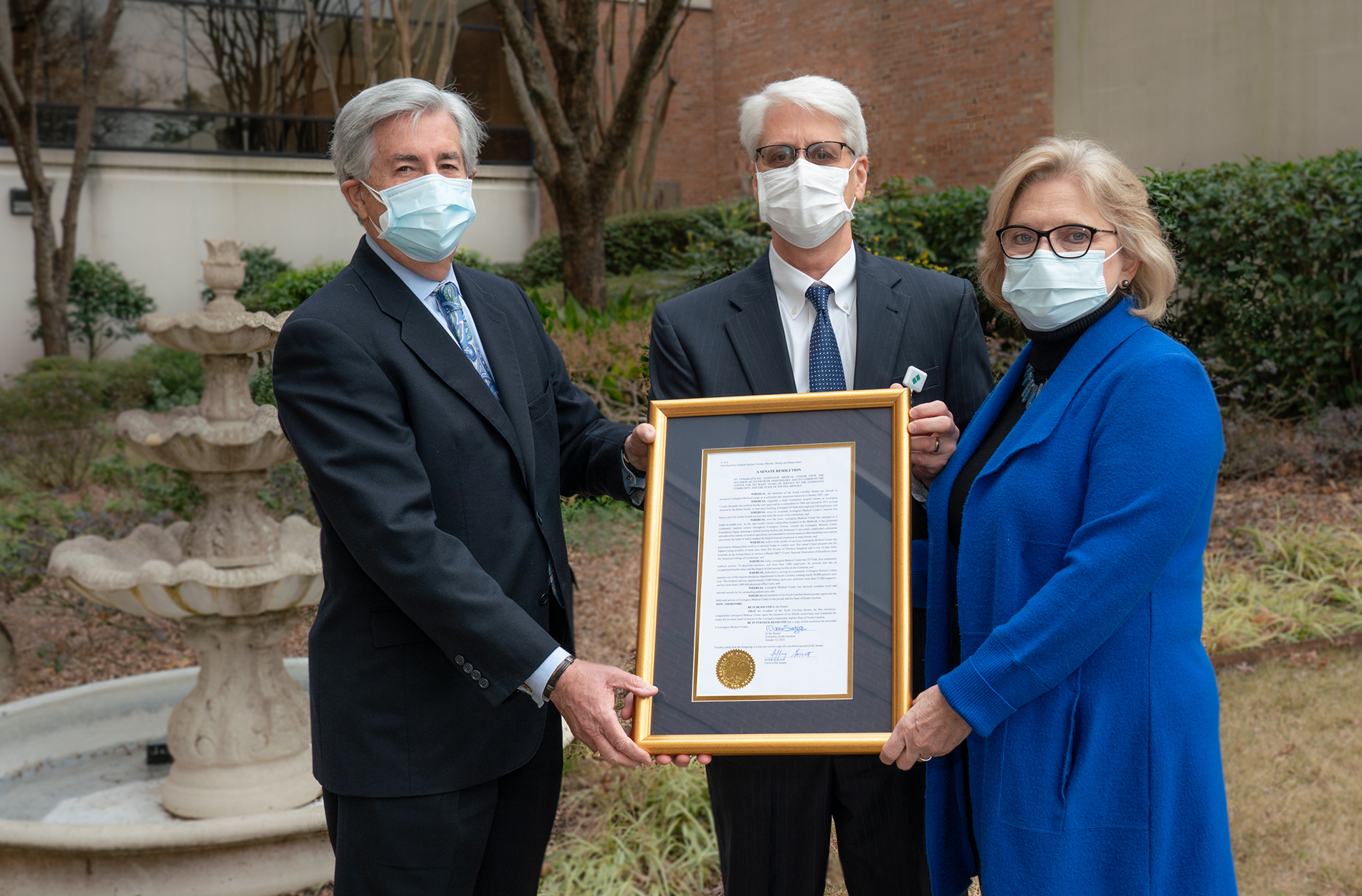 Sen. Setzler and Sen. Shealy present proclamation to LMC CEO