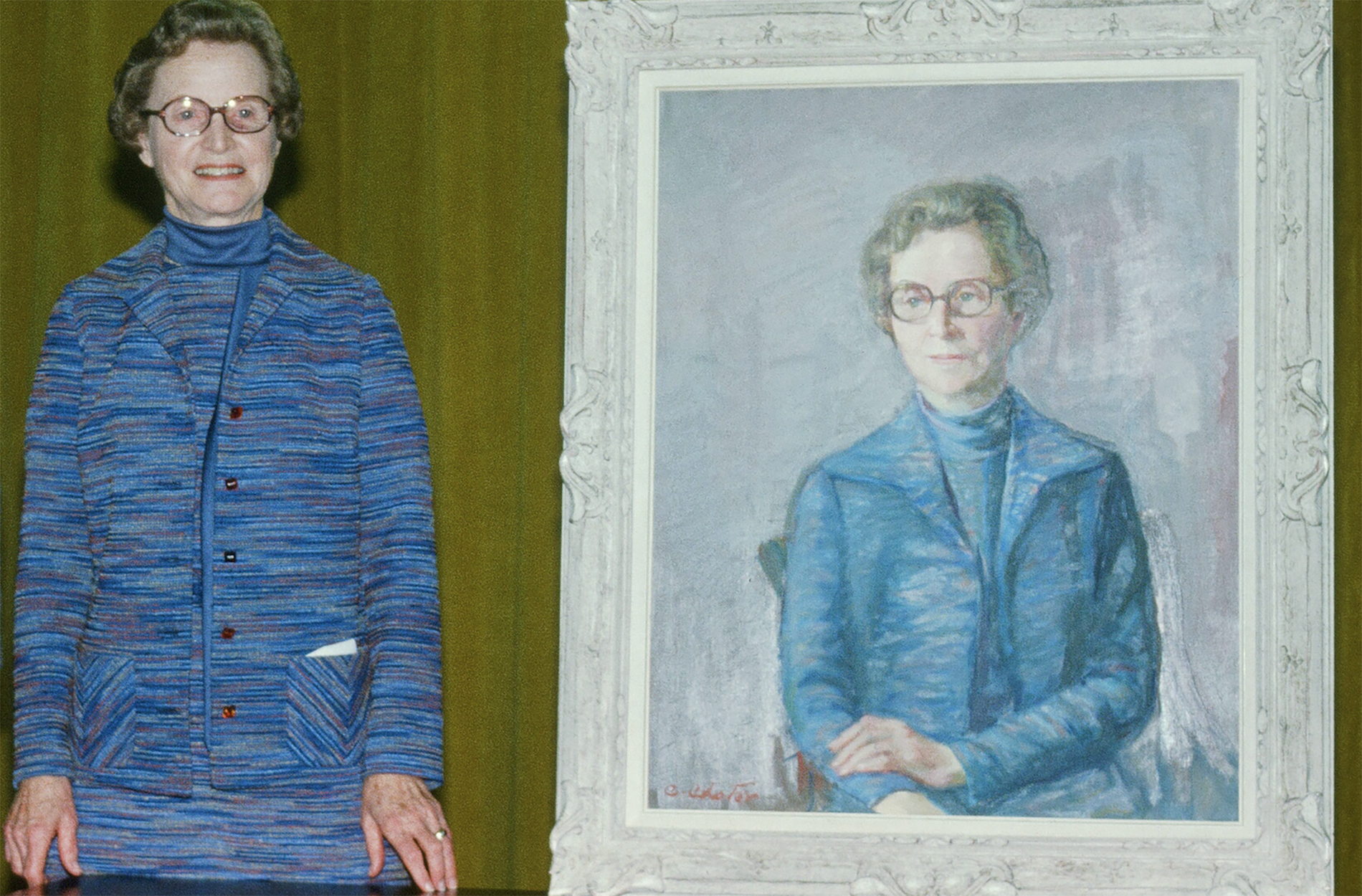 Ms. Medhurst standing next to her portrait