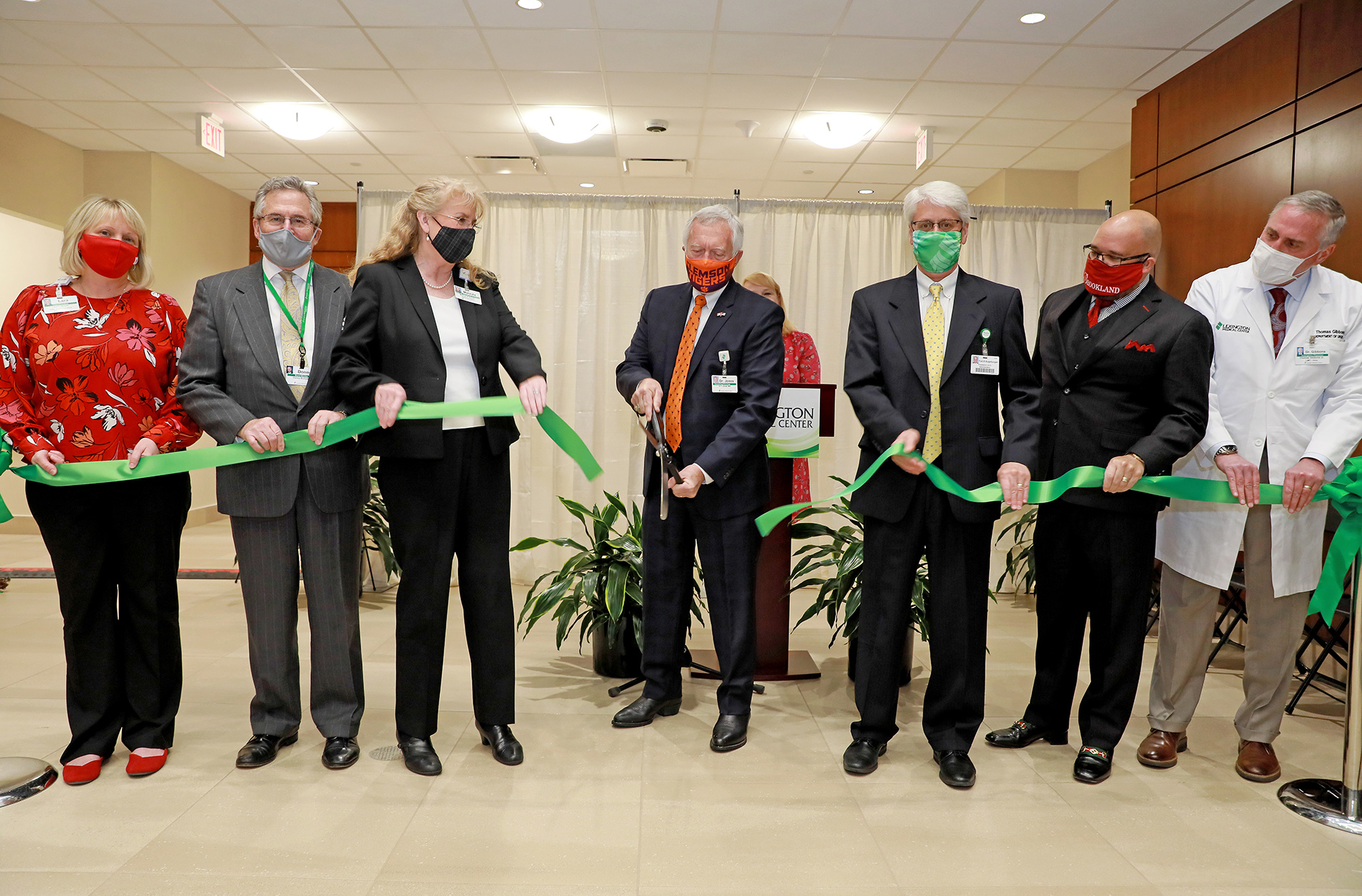 LMC Board Chair and others cutting ribbon