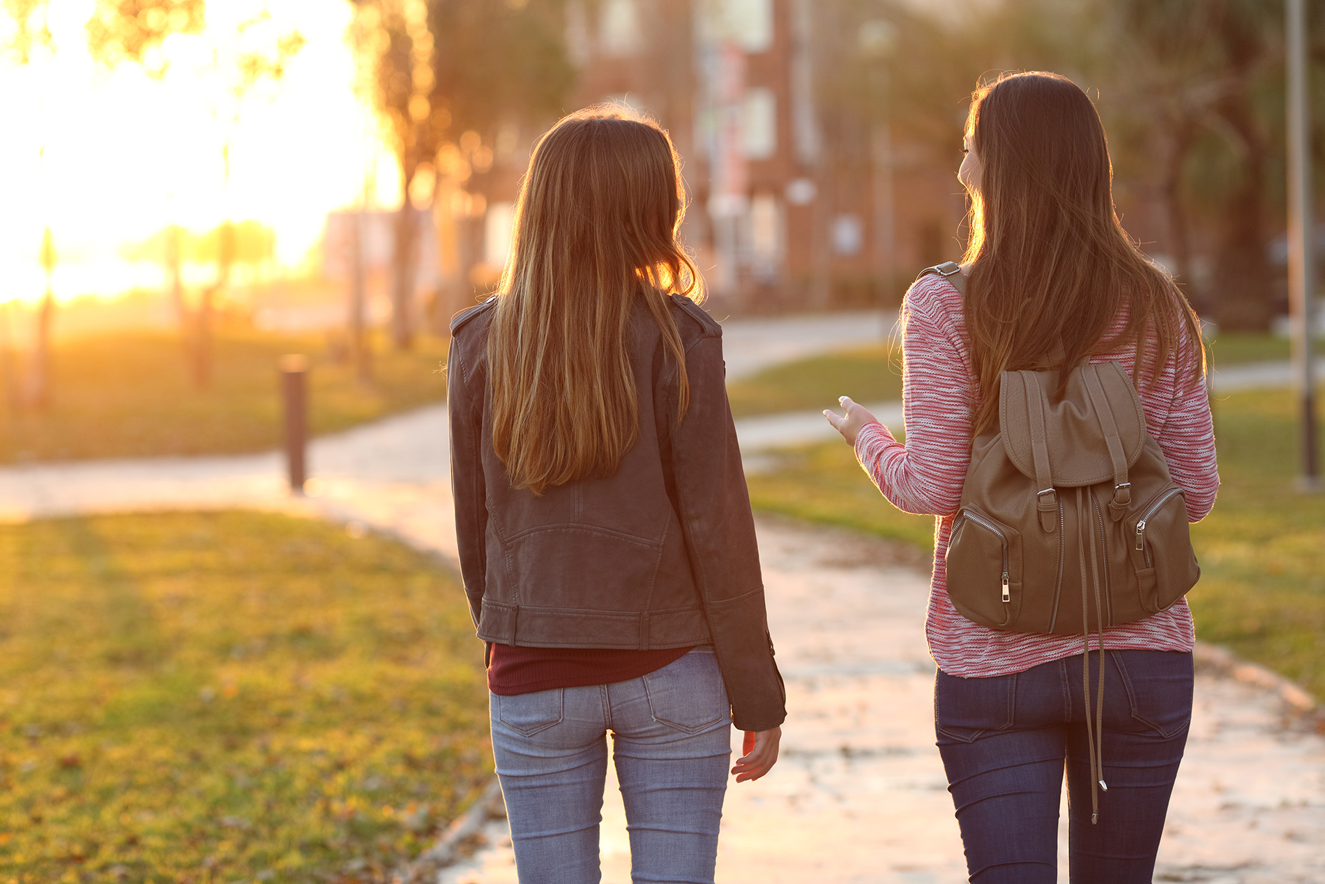 Teens girls walking with backpacks