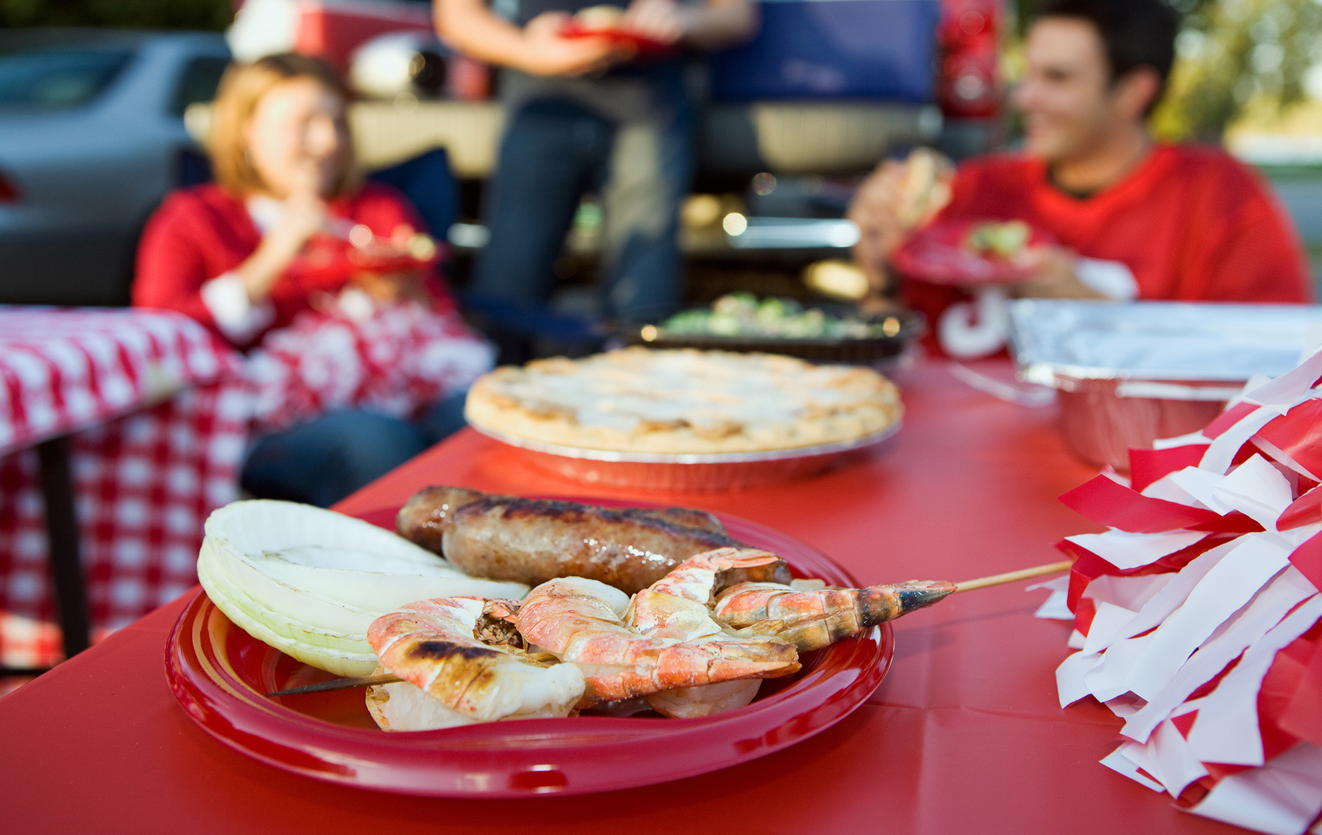 shrimp and meat on platter at tailgate event