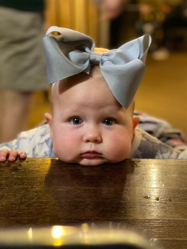 Baby resting her face on table
