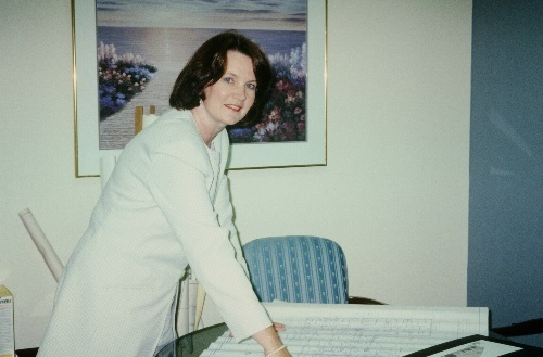 Photo of Barbara Willm in her office in 1998